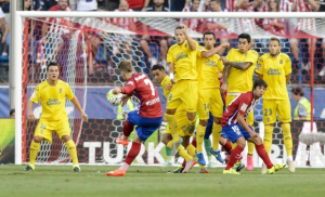 Late blows stunned Atletico Madrid at the Calderon